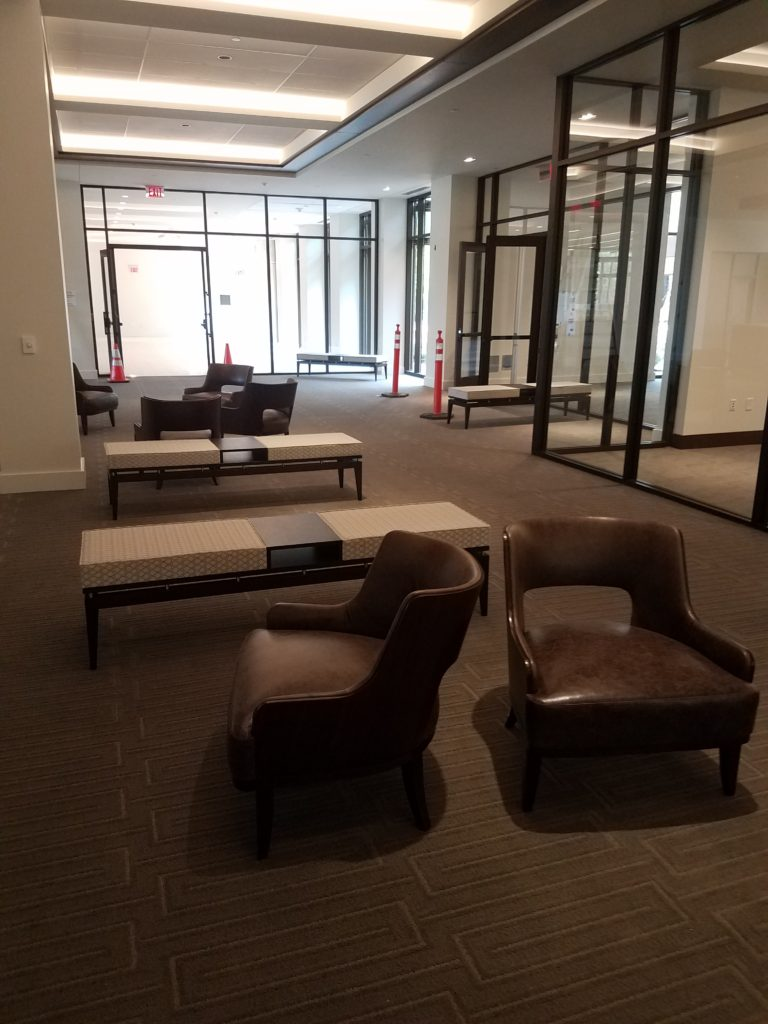 three benches; six chairs; glass walls and exterior doors