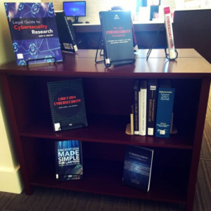 bookshelf containing books on cybersecurity