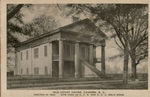 "sepia photo of classic two story building. ""Old Court House Camden, S.C. Erected in 1820. Now used as D.A.R. and U.D.C. Relic Room"""